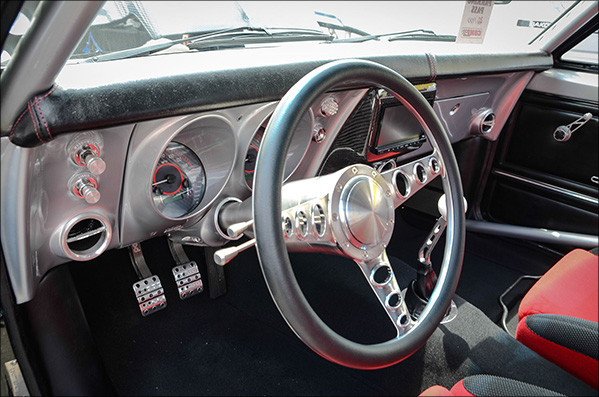 The interior is equal parts racecar and cruiser