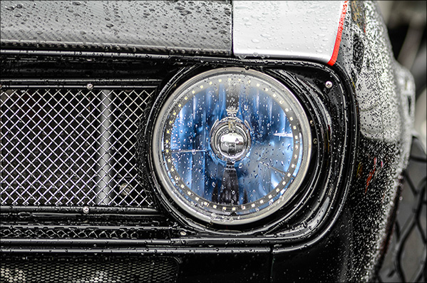 Closeup of '67 Camaro in the rain